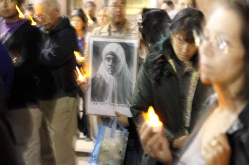 Around 200 people filled the Japanese American National Museum plaza for the silent, candlelight vigil. Photo by Mark Vallen ©.