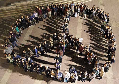 At the end of the vigil, participants formed a giant peace sign in the museum's plaza. This photograph was taken from the museum's rooftop. Photo by Mark Vallen ©.