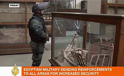 Pro-Democracy demonstrators rushed to protect the Egyptian Museum; they are pictured here guarding the museum entry gate in a still from a video by Euronews. Photo courtesy of AFP