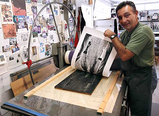 Greco reveals the very first print to come off the press. Photograph by Mark Vallen ©