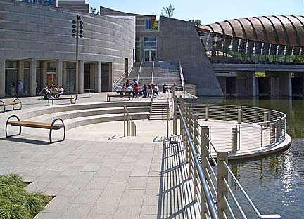 View of the Walker Landing Plaza between galleries at the Crystal Bridges Museum of American Art in Bentonville, Arkansas USA. Photograph by Charvex/Wikimedia Creative Commons.