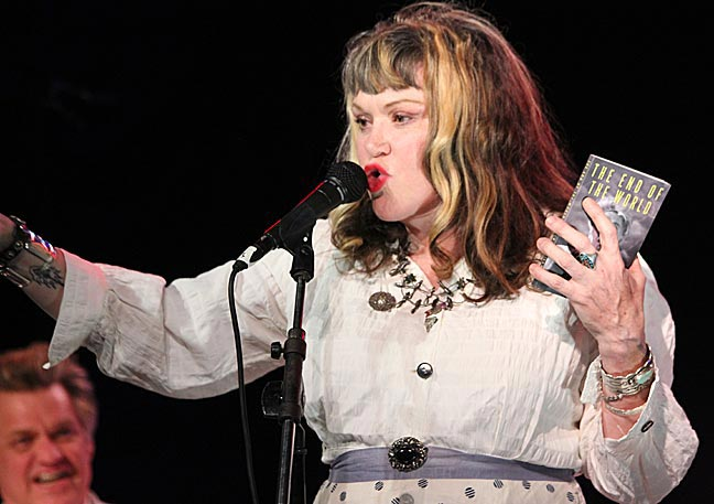 &quot;Exene and The End Of The World&quot; - Photo by Mark Vallen 2013 . Exene with Rev. Billy's &quot;The End Of The World&quot; book at The Echo club in Los Angeles.