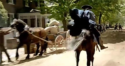 """As Revere rides his steed through the village while shouting 'The Italians are coming!' and the FIAT 500Ls enter the township, something odd stirs in the settlement."" Screenshot from Fiat's Italian Invasion commercial."