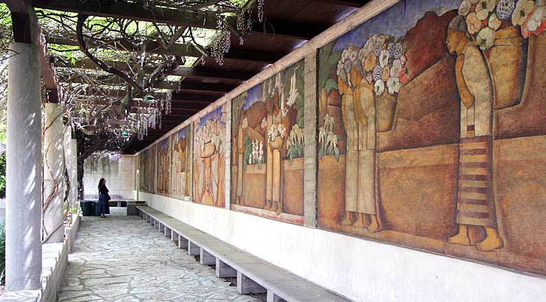 "A view of Martínez' unfinished fresco mural, ""The Flower Vendors."" The mural is over 100 feet long and consists of several panels. Photo by Mark Vallen ©."