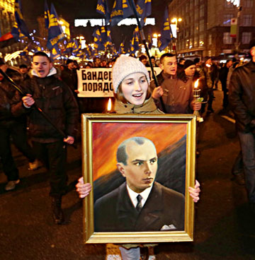 During the Maidan protests, Svoboda organized a Jan. 1, 2014 torchlight march in Kiev to honor Ukraine's WWII era ultranationalist, Stepan Bandera (1909-1959). The procession was held on what would have been Bandera's 105th birthday. 15,000 extremists carried Svoboda banners and the red and black battle flag of Bandera's paramilitary, the Ukrainian Insurgent Army. (AP Photo by Efrem Lukatsky).