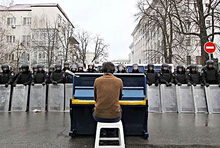 Chopin Performance. 2013. Mariyan Mitsik. As mentioned in the ARTnews article, Icons on the Barricades, Mitsik performed in the streets at a piano painted in the colors of the Ukrainian flag.