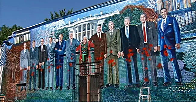 "Karlísima's defaced ""Presidential Mural."" Video screen capture from Channel 4 NBC Washington."