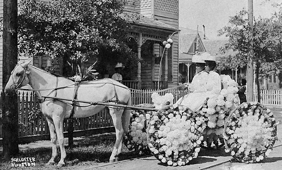 Two women sitting in a buggy decorated with flowers at the annual Juneteenth Emancipation Day celebration in Houston, Texas, 1906. Left to right: Martha Yates Jones and Pinkie Yates. Source: Houston Public Library Digital Archives.
