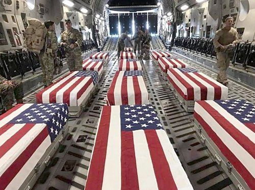 The bodies of 13 US service members killed in terrorist suicide bombing at Hamid Karzai International Airport, return home on Aug. 28, 2021.